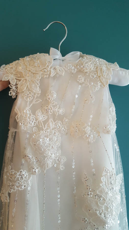 front of toris christening gown