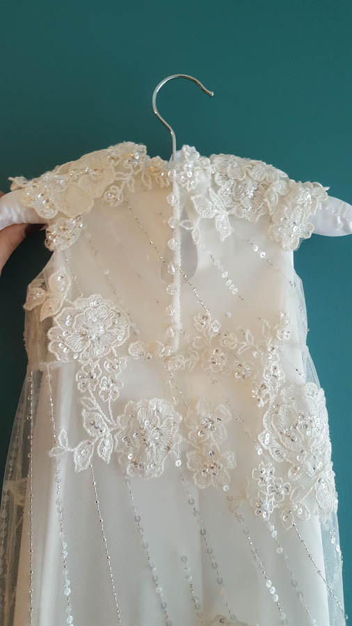 back of toris christening gown